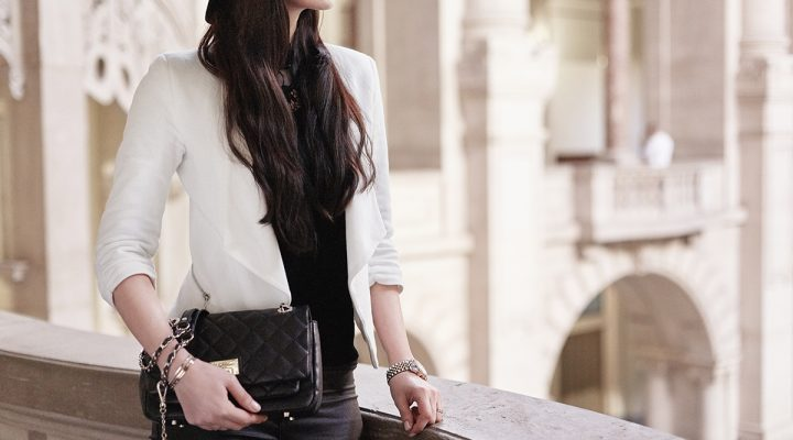 White Blazer over a black jersey with black pants